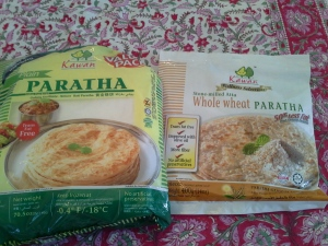 You can find parathas in the freezer section of the Indian grocery store, or larger Asian grocery stores