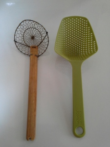 Use scoopy things like this, or thongs, a sieve or anything else that will accomplish the same goal of veggies out of hot water.