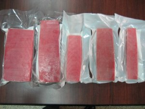 Blocks of frozen tuna come in different sizes and sometimes pre-sliced.  Make sure it is sushi-grade!