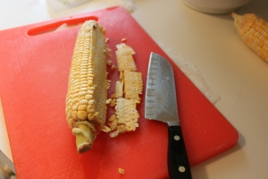 Get a firm hold of the cob and cut off the kernels