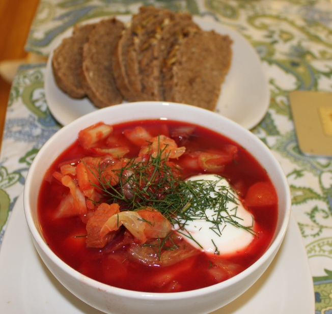 Borscht with sour cream and dill served with hearty bread