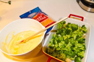 Layer the chicken, then broccoli, then the sauce and then cheese